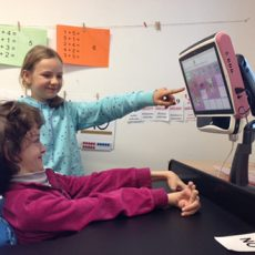 Isabel uses the Tobii eye tracking communicator