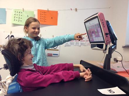 Isabel uses the Tobii eye tracking communicator