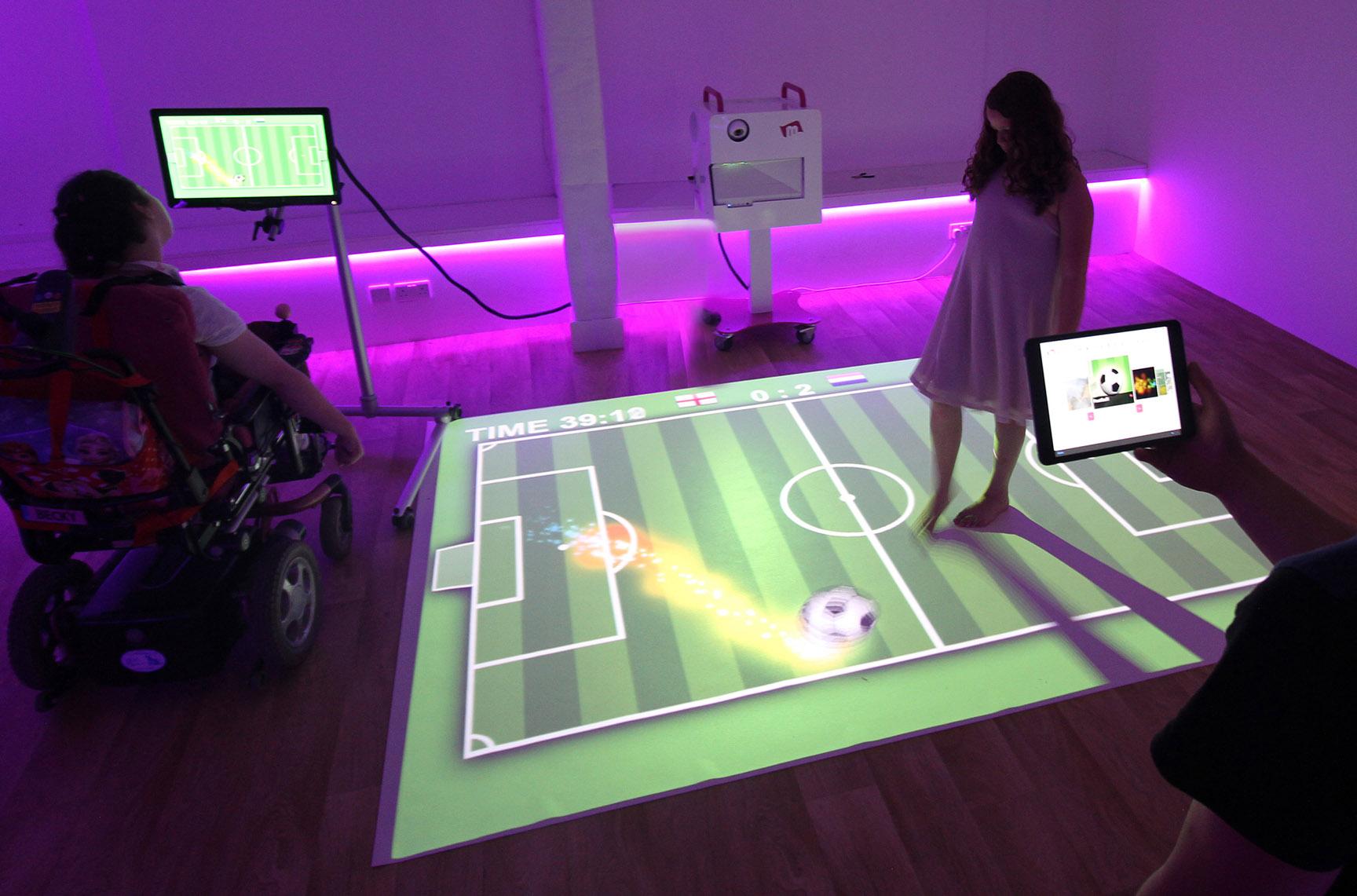 children play soccer game for sensory room