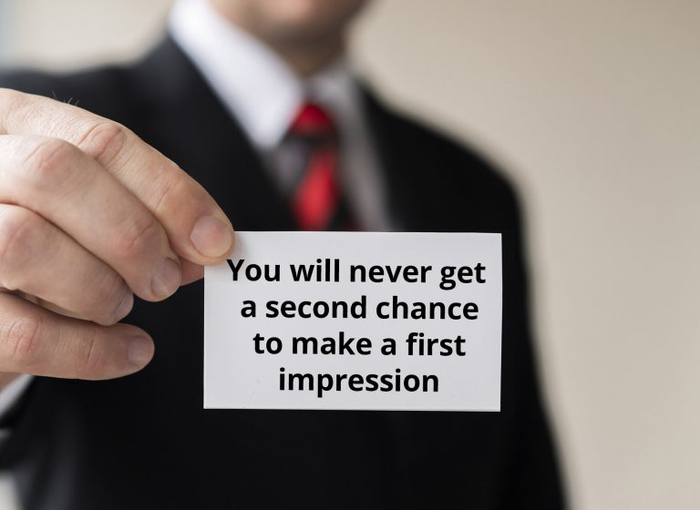 man holding businesscard first impression